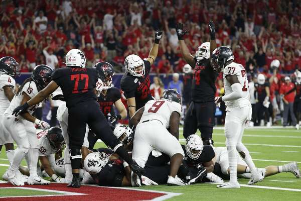 Houston Cougars celebrate their touchdown during the second quarter of the AdvoCare Texas Kickoff game at NRG Stadium, Friday, Sept. 13, 2019, in Houston.