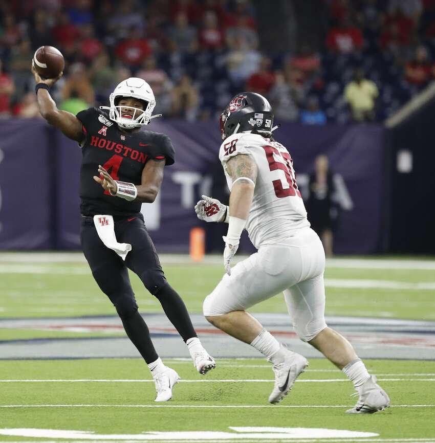 Houston Cougars quarterback D'Eriq King (4) passes the ball against Washington State Cougars defensive lineman Karson Block (50) during the fourth quarter of the AdvoCare Texas Kickoff game at NRG Stadium, Friday, Sept. 13, 2019, in Houston.