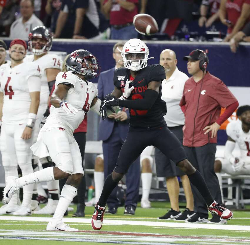 Houston Cougars wide receiver Jeremy Singleton (13) tries to catch a pass against Washington State Cougars cornerback Marcus Strong (4) during the third quarter of the AdvoCare Texas Kickoff game at NRG Stadium, Friday, Sept. 13, 2019, in Houston.