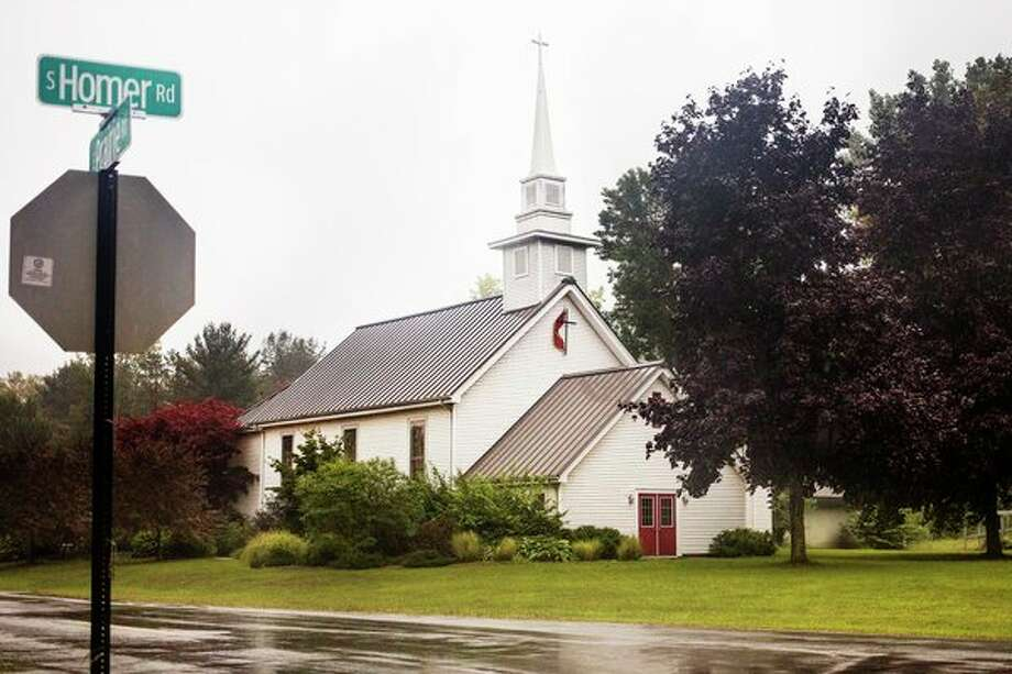 Homer United Methodist Church, located at the corner of South Homer and East Prairie roads, is celebrating its 130th anniversary on Sunday, Sept. 15. (Katy Kildee/kkildee@mdn.net)
