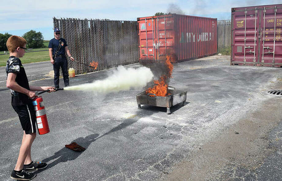 Photos from a Jacksonville High School and Jacksonville Fire Department fire extinguisher demonstration on Friday. Photo: Marco Cartolano | Journal-Courier