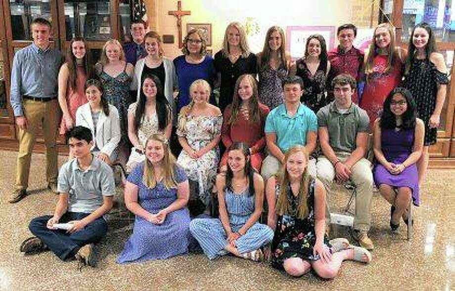 Routt Catholic High School inducted members of the school's chapter of the National English Honor Society during a ceremony Thursday at the school. Photo: Photo Provided