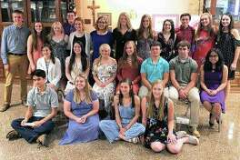Routt Catholic High School inducted members of the school's chapter of the National English Honor Society during a ceremony Thursday at the school.