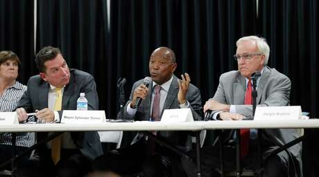 Mayor Sylvester Turner argues with Bill King as Tony Buzbee listens during a mayoral candidate forum for the 2019 election at the Garden Oaks Montessori Magnet school, September 3, 2019, in Houston. This is Mayor Sylvester Turner's first candidate forum. The forum is hosted by Super Neighborhood 12 and the Garden Oaks Civic Club.