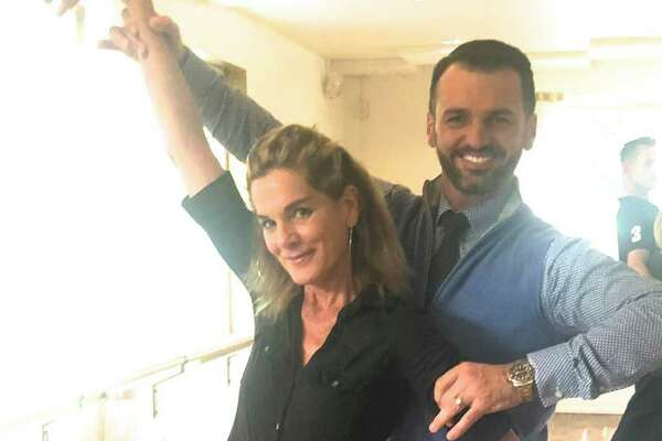 "Susie Costaregni, aka The Dish, strikes a pose with Tony Dovolani, a star of ""Dancing with the Star,"" at the Arthur Murray Dance Studio in Greenwich on Tuesday."