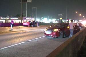 """A woman who was trying to walk across the North Freeway early Saturday morning was struck by """"at least one car"""" and taken to the hospital in critical condition, according to police."""