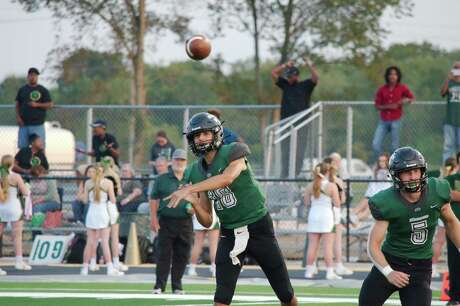Lutheran South Academy quarterback Luke Harrison (18) fires a pass against Beaumont Legacy Christian in the first half Friday at Lutheran South Academy.