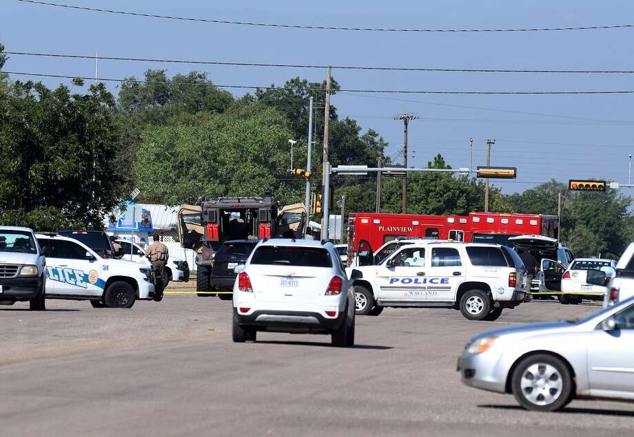 Plainview emergency units swarm the scene after a call stated that three shots had been fired on Friday morning on the 1600 block of West 11th Street. Photo: Josh Harris/For The Herald