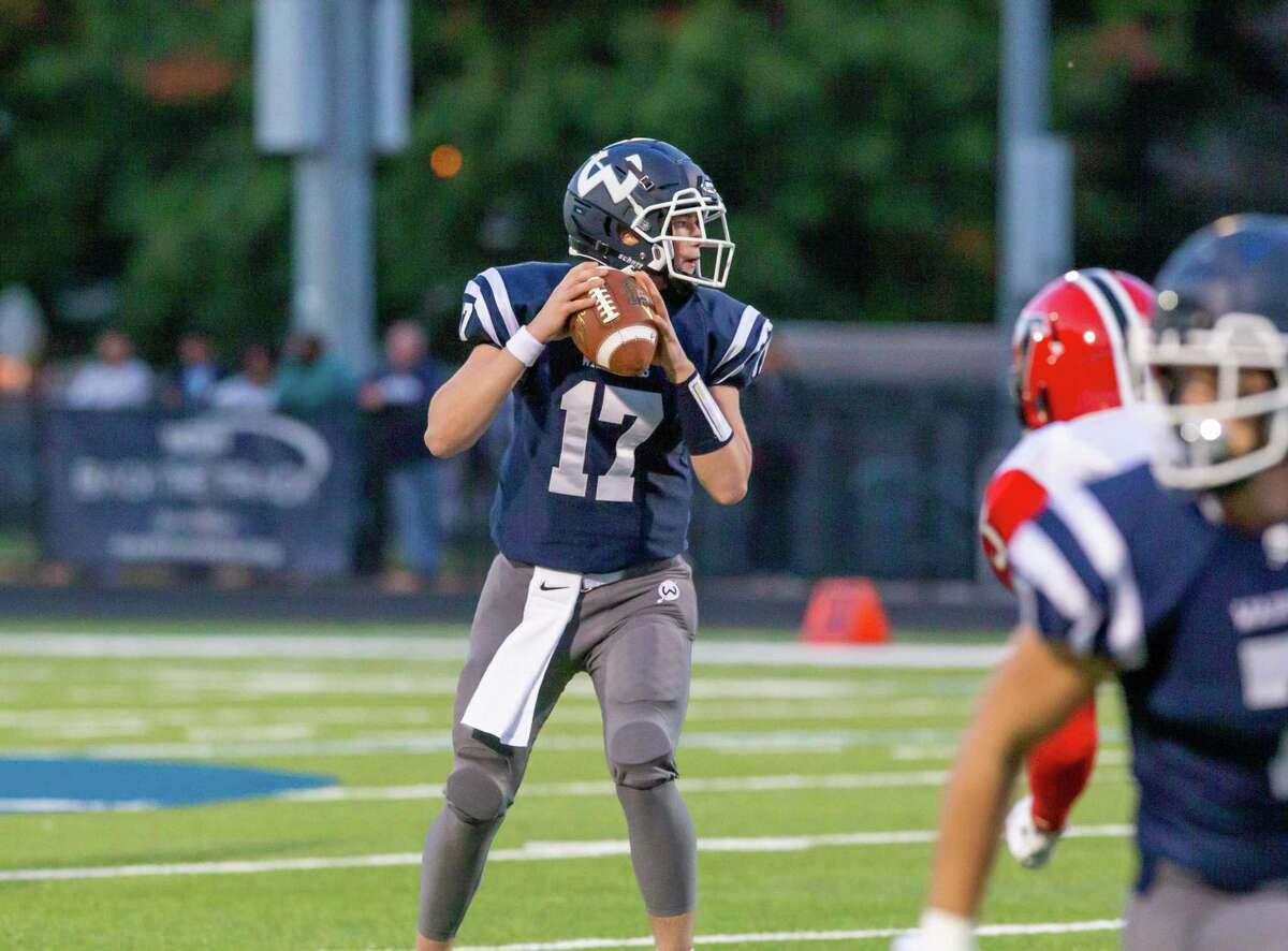 Jimmy O'Brien drops back to pass in Wilton's 31-14 win over Fitch. The senior completed 19-of-23 passes for more than 200 yards.