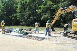 One of the main thoroughfares in The Woodlands, the six-lane Research Forest Drive corridor, is totally closed in both east and west directions Saturday, Sept. 14. A 30-inch water pipeline owned by the San Jacinto River Authority that goes under the road developed a break Friday afternoon, causing the road to be closed as work crews dig 12 feet into the ground to try to fix the problem. There is no timeline as of noon Saturday for the road to reopen.