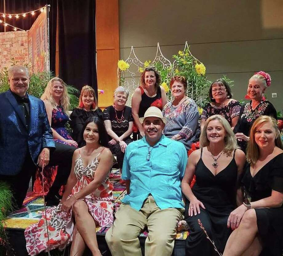 The Conroe Noon Lions Club - Dinner/Dance & Auction Committee didn't look to worst for the wear at the end of Thursday night's event with approximately 500 people in attendance for the Latin themed ' Noche de el Leon' fund raising event. Photo: Courtesy Photo