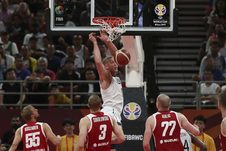 Mason Plumlee dunks over Poland's defense as the U.S. finishes seventh with an 87-74 victory. Photo: Ng Han Guan / Associated Press