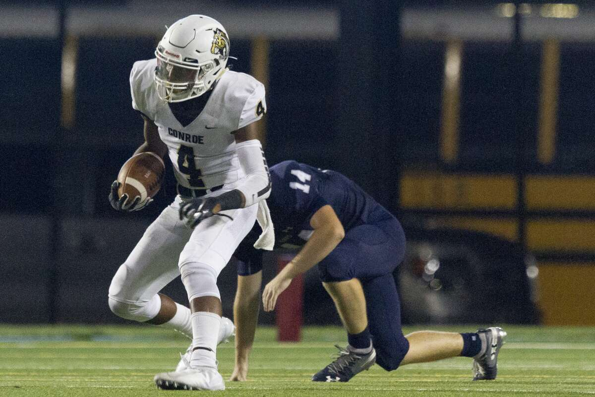Conroe wide receiver Michael Phoenix (4) has soared in the early going this season.