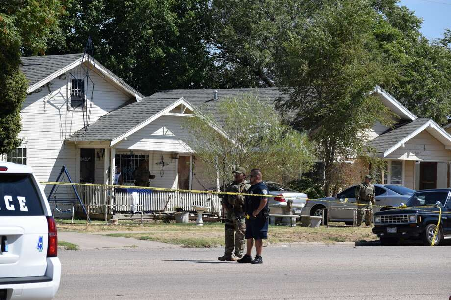 Law enforcement comb the scene where a man was killed Saturday in an officer-involved shooting. Photo: Ellysa Harris/Plainview Herald