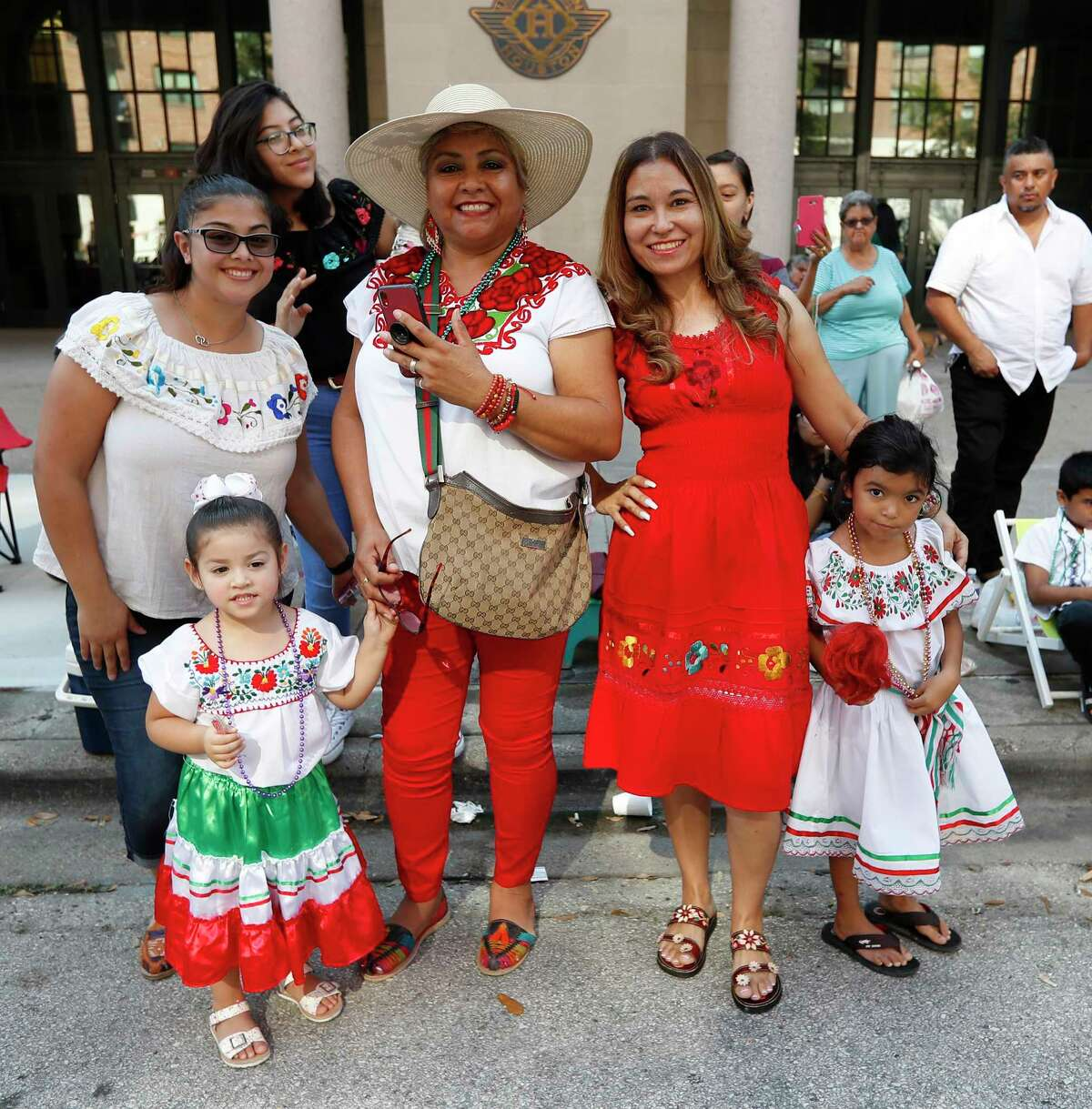 Parade-goers watch the Houston Fiestas Patrias Parade downtown, celebrating the Mexican Independence Day, Saturday, Sept. 14, 2019, in Houston.