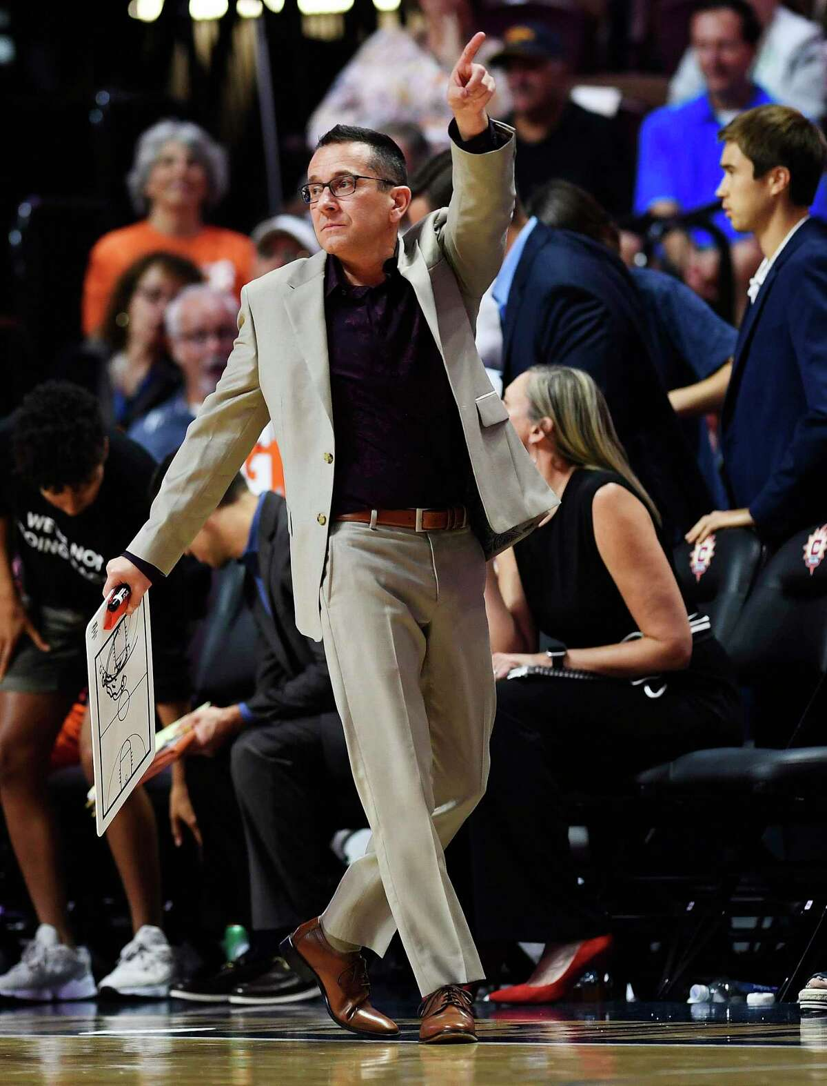 Connecticut Sun coach Curt Miller motions during the team's game against the Dallas Wings on Sept. 4, 2019, in Uncasville.