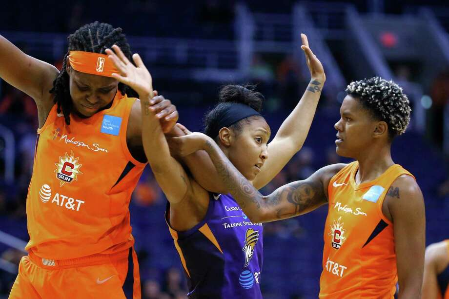 Connecticut Sun guard Courtney Williams, right, pulls apart Sun forward Jonquel Jones, left, and Phoenix Mercury guard Briann January, middle, during the second half of a game Wednesday, Aug. 14, 2019, in Phoenix. Photo: Ross D. Franklin / Associated Press / Copyright 2019 The Associated Press. All rights reserved
