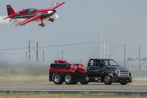Jerry McCart races his jet powered Ford truck against Mike Gallaway in his Extra 300 SX down the runway 09/14/19 at the 2019 High Sky Wing Commemorative Air Force AirSho. Tim Fischer/Reporter-Telegram