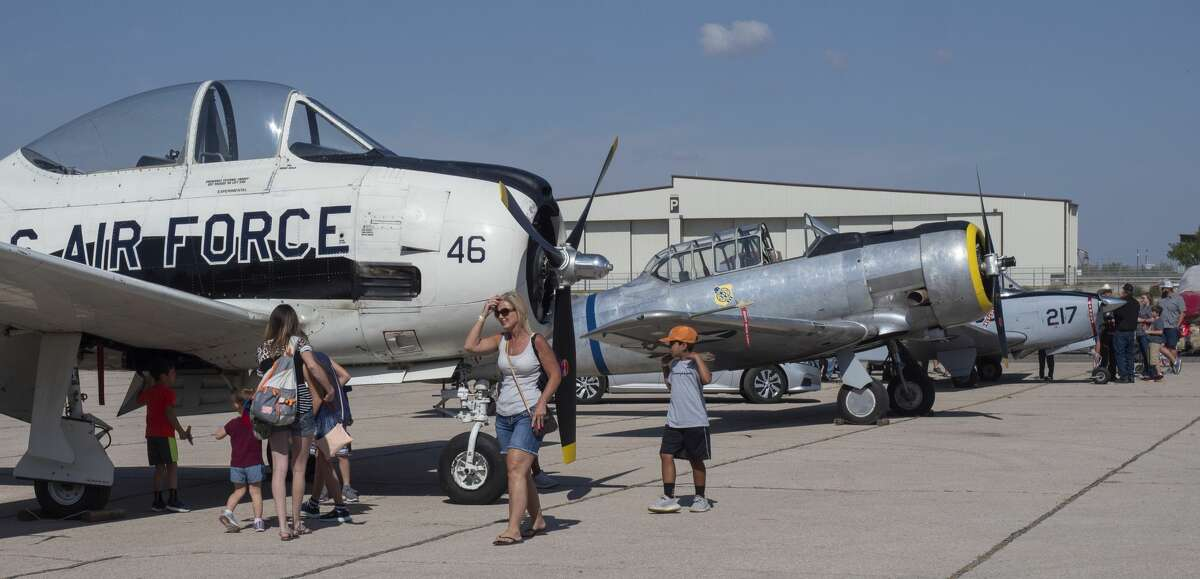 Airplane aficionados walk around vintage aircraft 09/14/19 before the 2019 High Sky Wing Commemorative Air Force AirSho. Tim Fischer/Reporter-Telegram