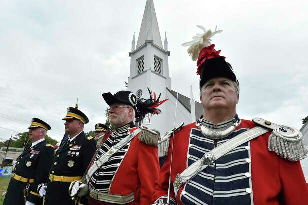 Branford, Connecticut - Saturday, September 14, 2019: Second Company Governor's Foot Guard host the Joint Review of the Governor's Guards of Connecticut Saturday afternoon on the Branford Green as part of of Branford's 375th Anniversary celebration. During the Joint Military Review that is open to the public, the Connecticut Military Department reviews the troops and distribute long service medals and Soldier of the Year Awards. The four distinct units of the Connecticut State Guard which is a part of the organized militia under the Connecticut State Militia are the the First Company Governor's Foot Guard of Hartford, the Second Company Governor's Foot Guard of Branford, the First Company Governor's Horse Guard of Avon, and the Second Company Governor's Horse Guard of Newtown.