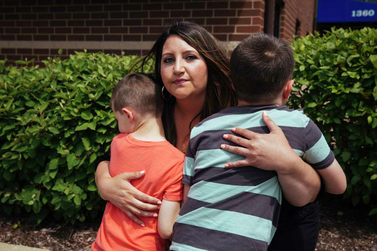 Danielle Rizzo with her boys, ages 6 and 7, in Streamwood, Ill. After finding out her sons were part of an autism cluster, she sued the sperm bank and its parent company.