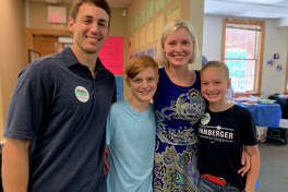 Sarabeth Spasojevich, with husband Steve and children Andrew and Simone, says she began voting in off-year elections and campaigning for Democrats after the 2016 presidential election.
