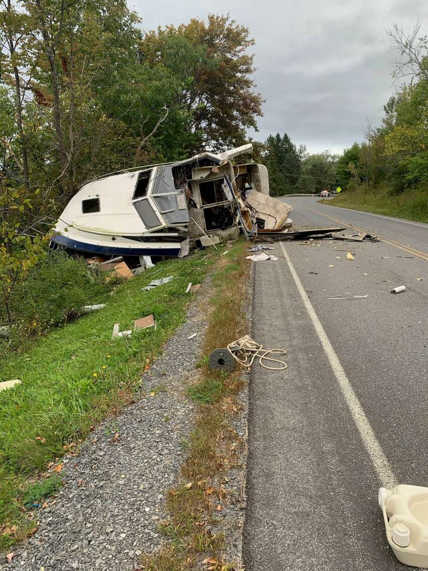 A boat fell off its trailer as it was being hauled down Helderberg Trail in the Albany County town of Berne on Saturday, Sept. 14, 2019. There were no reports of injuries, but the boat sustained damage. (Albany County Sheriff's Office photo)