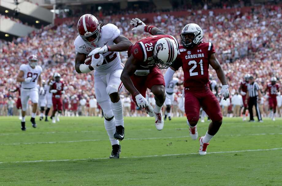 Alabama running back Najee Harris (left), who is from Antioch, knocks over South Carolina's J.T. Ibe (29) on his way to the end zone for a 42-yard scoring reception, his second. Harris is the first Tide running back in 20 seasons to score multiple receiving TDs in a game. Photo: Streeter Lecka / Getty Images