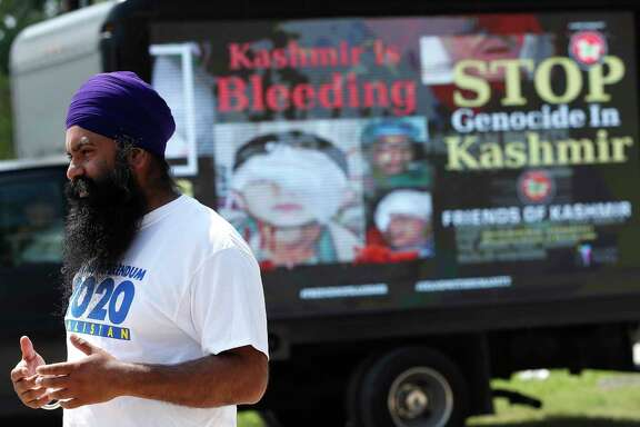 """Jagdeep Singh talks about his involvement with the """"Go Back Modi"""" campaign during a truck rally at the Sikh National Center Gurdwara, Saturday, Sept. 14, 2019, in Houston. The rally is organized by the national human rights organization Sikhs for Justice and Friends of Kashmir, comprising of Kashmiri and Sikh people who are protesting Prime Minister Modi and his forthcoming appearance on Sunday September 22nd at NSG stadium, where 30,000 demonstrators are expected to protest India's actions in Kashmir and Punjab."""