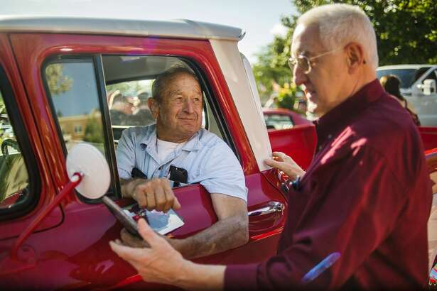Midland residents Herb Michels, left, and Ron Gillespie, right, chat before Michels drives his Chevrolet Apache 10 in the Cruise 'N Car Show Saturday evening in downtown Midland. (Katy Kildee/kkildee@mdn.net)
