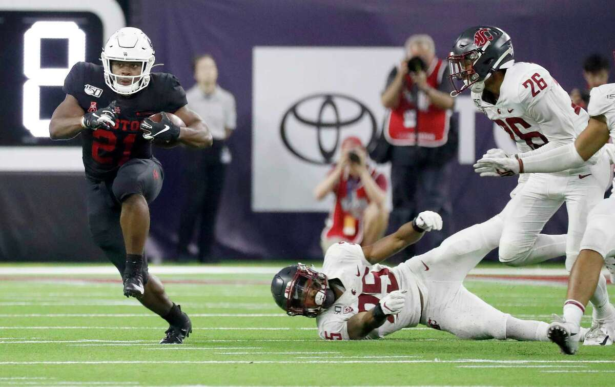 After missing the season's first two games, Patrick Carr returned and amassed 77 yards rushing in UH's loss to Washington State.