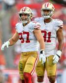 TAMPA, FL - SEPTEMBER 08: San Francisco 49ers Defensive End Nick Bosa (97) and San Francisco 49ers Defensive End Arik Armstead (91) during the second half of the season opener between the San Francisco 49ers and the Tampa Bay Bucs on September 08, 2019, at Raymond James Stadium in Tampa, FL. (Photo by Roy K. Miller/Icon Sportswire via Getty Images)
