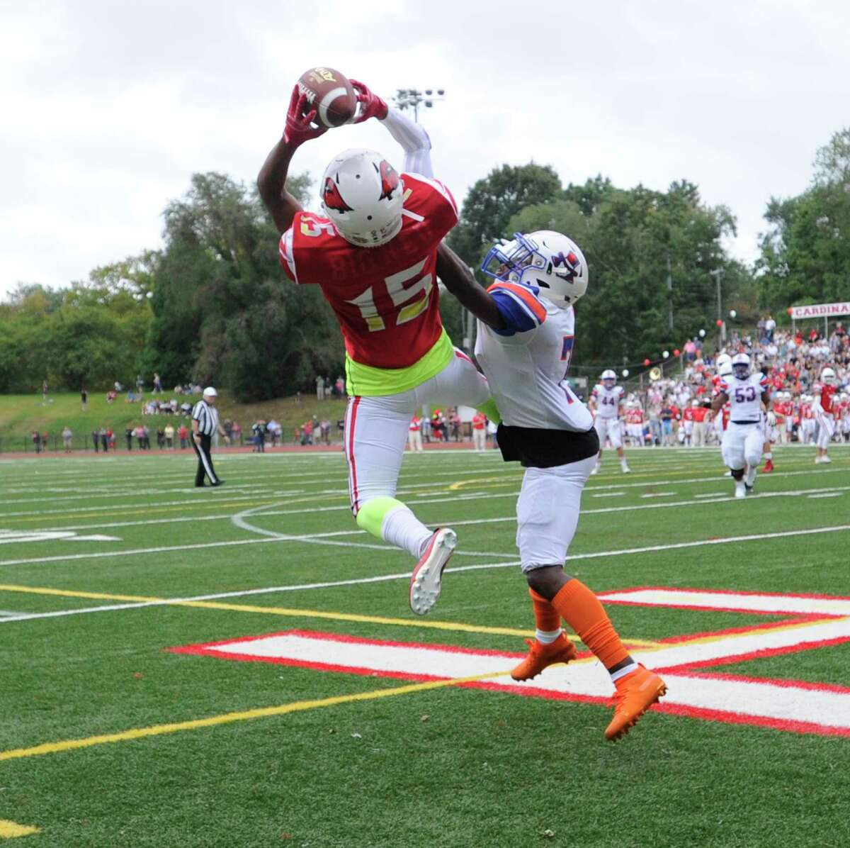 Greenwich's AJ Barber (15) catches a pass for a touchdown against Danbury's Xavier Ross (7) in an FCIAC football season opener at Cardinal Stadium on Sept. 14, 2019 in Greenwich, Connecticut.