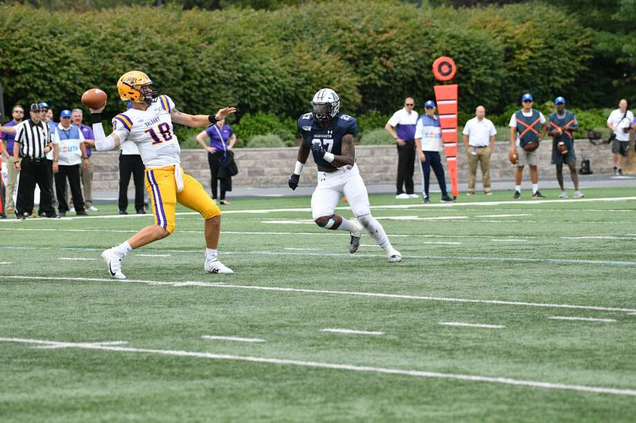 UAlbany quarterback Jeff Undercuffler gets away a pass as Monmouth's Deandre Clifton closes in during their football game on Saturday, Sept. 14, 2019, at Kessler Field in West Long Branch, N.J. (Courtesy of Patrick Tewey) Photo: Courtesy Of Patrick Tewey