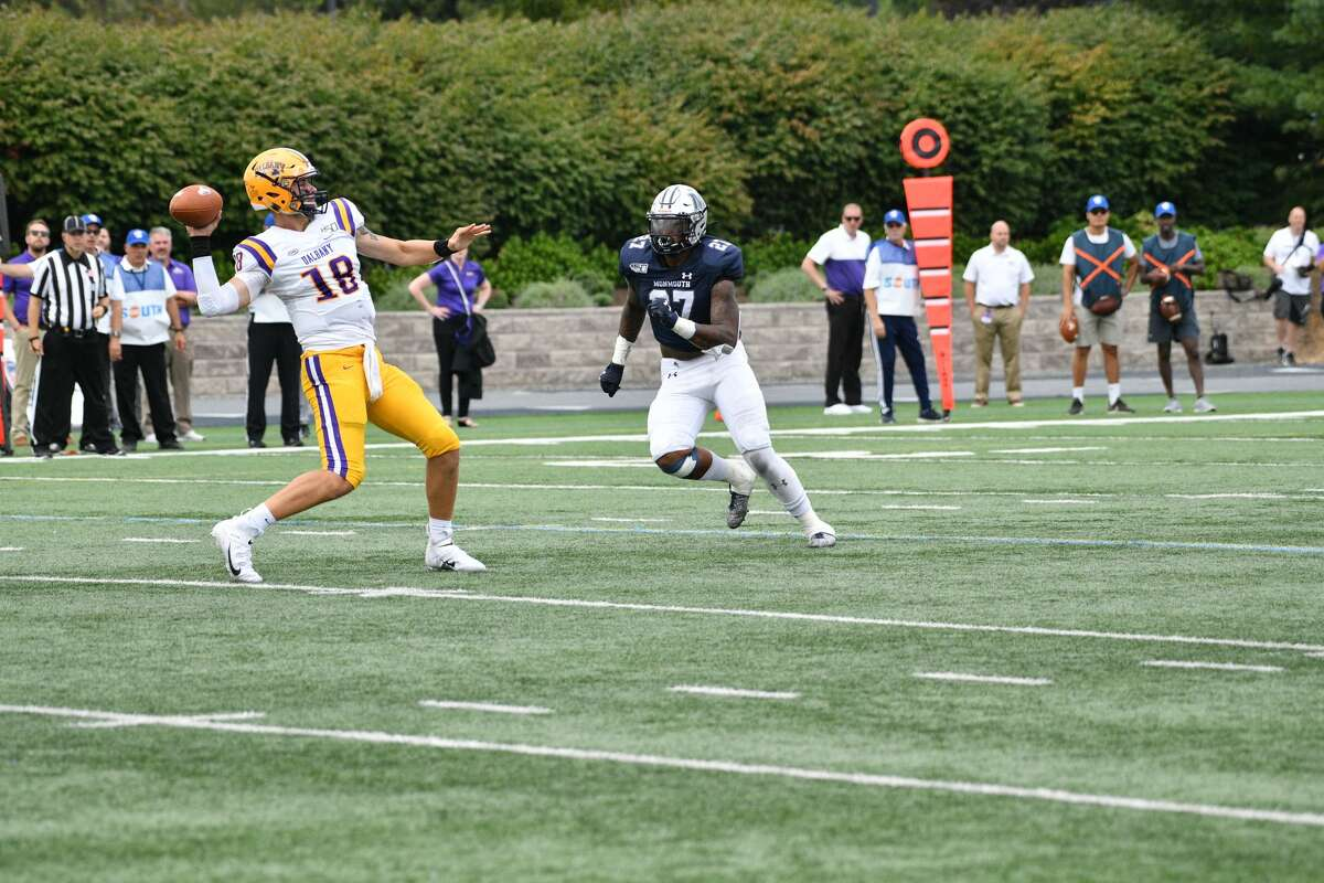 UAlbany quarterback Jeff Undercuffler gets away a pass as Monmouth's Deandre Clifton closes in during their football game on Saturday, Sept. 14, 2019, at Kessler Field in West Long Branch, N.J. (Courtesy of Patrick Tewey)