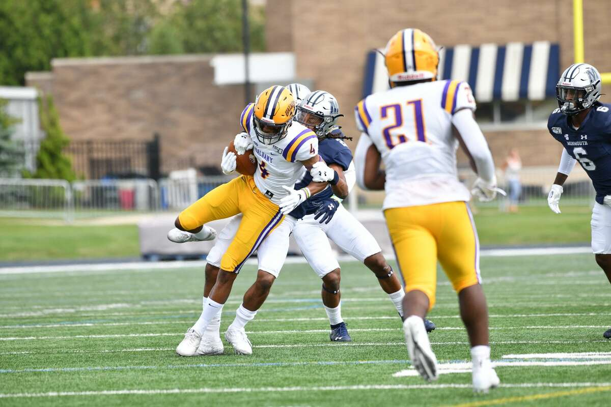 UAlbany receiver Juwan Green fights for yardage against Monmouth during their game on Saturday, Sept. 14, 2019, at Kessler Field in West Long Branch, N.J. (Courtesy of Patrick Tewey)