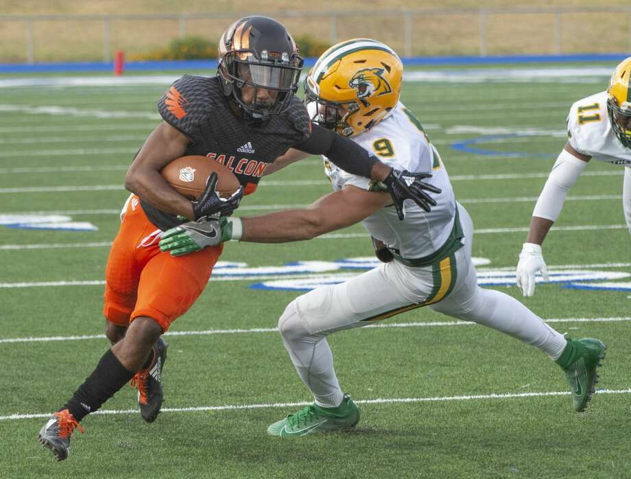 UTPB's Kobe Robinson tries to get some extra yards after a catch as Northern Michigan's Brady Hanson holds on to bring him down 09/14/19 at Grande Communications Stadium. Tim Fischer/Reporter-Telegram Photo: Tim Fischer/Midland Reporter-Telegram