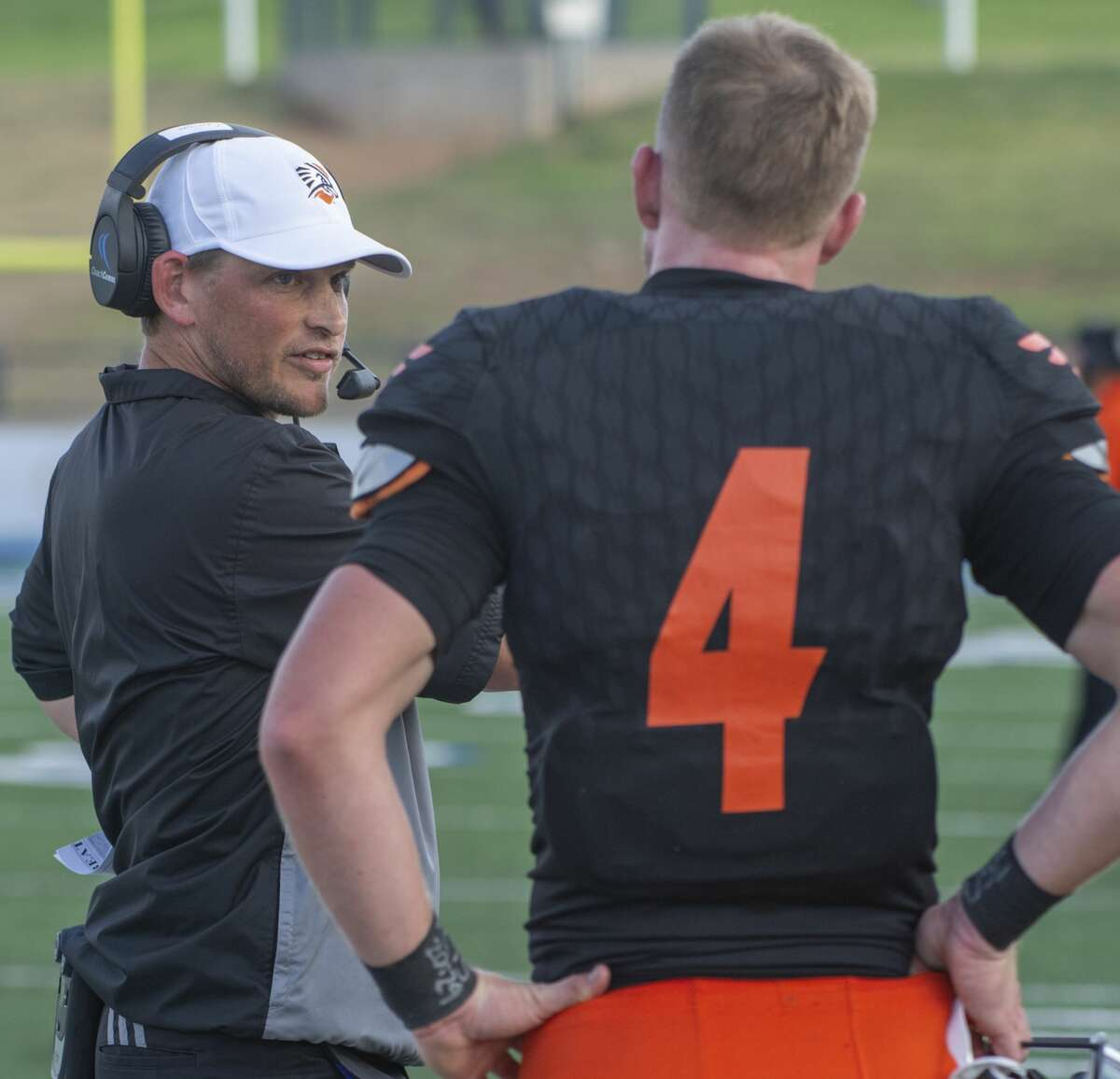 UTPB head coach Justin Carrigan talks with his quarterback Kameron Mathis during a defensive series 09/14/19 as they play Nothern Michigan at Grande Communications Stadium. Tim Fischer/Reporter-Telegram