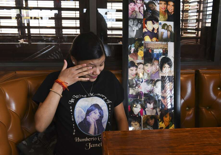 """Sister to late Humberto """"Janelle"""" Ortiz, Rose Ortiz, clears her eye as she sits next to a collage of photos featuring Janelle, Tuesday, Sep. 10, 2019. Photo: Danny Zaragoza, Laredo Morning Times"""