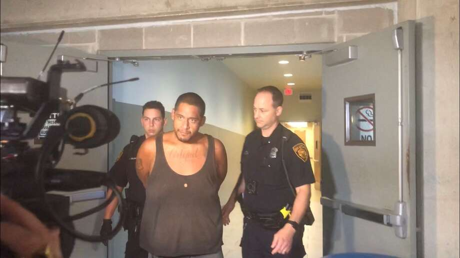 Juan Fragosa, 26, being escorted out by the San Antonio Public Safety Headquarters on Saturday, September, 14, 2019. Photo: Sara Cline