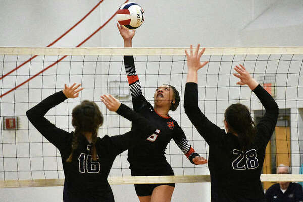 Edwardsville's Alexa Harris goes up for an attack during the third-place match against Breese Central.