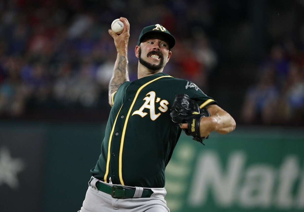 Oakland Athletics starting pitcher Mike Fiers throws to the Texas Rangers in the second inning of a baseball game in Arlington, Texas, Saturday, Sept. 14, 2019. Fiers left the game in the same inning with an unknown injury. (AP Photo/Tony Gutierrez)