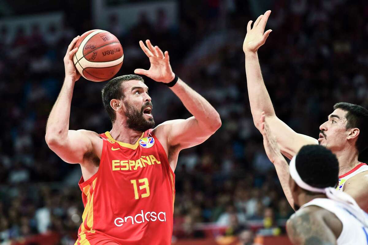 Spain's Marc Gasol, left in action during a group C match against Puerto Rico for the FIBA Basketball World Cup 2019 in Guangzhou in southern China's Guangdong province on Monday, Sept. 2, 2019. (AP Photo)