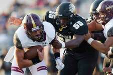 Foster tackle DeAundre Hicks (55) wraps up Magnolia West running back Hunter Bilbo (20) during the first quarter of a non-district high school football game at Guy K. Traylor Stadium, Saturday, Sept. 14, 2019, in Rosenberg.