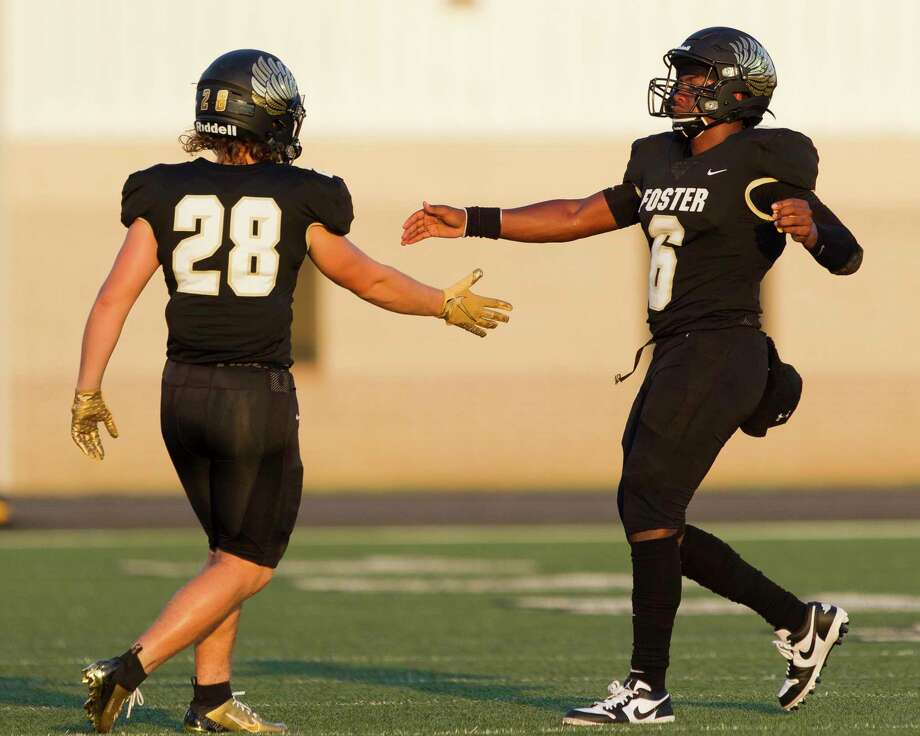 Foster quarterback Ryan Stubblefield (6) gets a high-five from tight end Parker Hearon (28) after throwing his third touchdown pass of the first half during a non-district high school football game at Guy K. Traylor Stadium, Saturday, Sept. 14, 2019, in Rosenberg. Stubblefield finished with four touchdowns in the opening half. Photo: Jason Fochtman, Houston Chronicle / Staff Photographer / Houston Chronicle