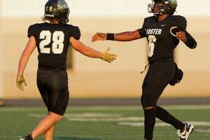 Foster quarterback Ryan Stubblefield (6) gets a high-five from tight end Parker Hearon (28) after throwing his third touchdown pass of the first half during a non-district high school football game at Guy K. Traylor Stadium, Saturday, Sept. 14, 2019, in Rosenberg. Stubblefield finished with four touchdowns in the opening half.