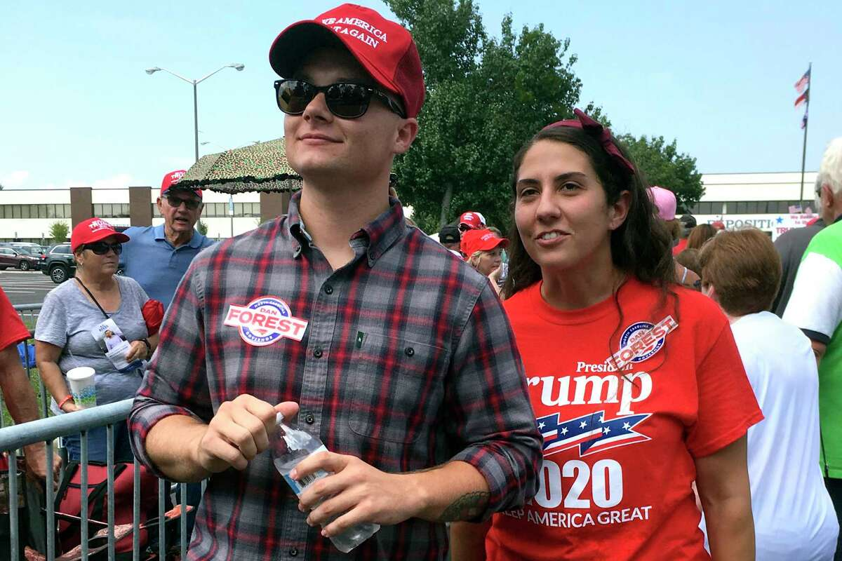 Ashley Arentz, 28, of Jacksonville, N.C., waits in line with friend Jonathan Ritter to enter a rally that President Donald Trump staged for Republican congressional candidate Dan Bishop in Fayetteville, N.C., Monday, Sept. 9, 2019. Arentz, a Marine, said she signed up to vote at the rally. Trumpa€™s campaign is on the hunt for political unicorns: Trumpa€™s team is searching for people in battleground states who support the president but didna€™t vote in 2016. (AP Photo/Alan Fram)