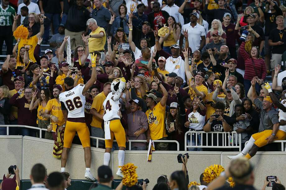 Arizona State players celebrate with fans who made the trip to East Lansing, Mich. Photo: Al Goldis / Associated Press