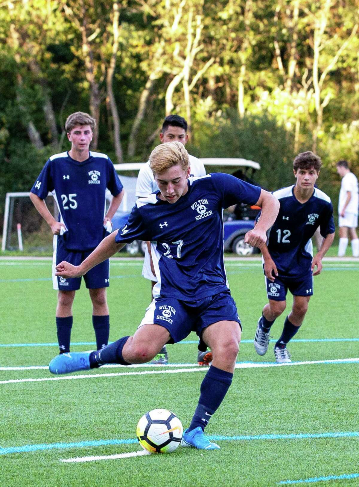 Will Hughes converts a penalty kick during Wilton's 6-1 win over St. Joseph.