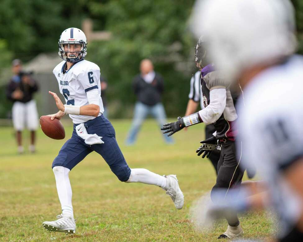 Cobleskill-Richmondville quarterback Tanner Moore looks for receiver Ryan Hiscock during a game against Holy Trinity at Notre Dame Bishop Gibbons on Saturday, Sept. 14, 2019 (Jim Franco/Special to the Times Union.)